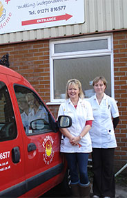 Carol Earner & Carol Swann, Directors of Phoenix Care At Home Ltd standing next to our wheelchair accessible hire vehicle